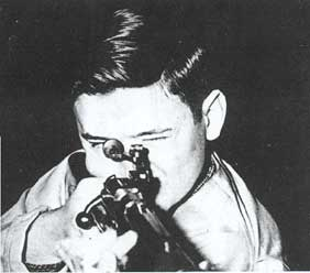 Rifle Team Captain Charles Palmer, four year veteran of the Rifle Team, prepares to fire during important match