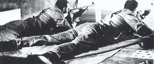 1962 Tech Rifle Team shooting in the prone position